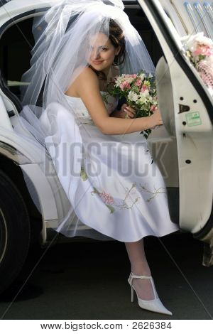 Bride Exiting Wedding Car Limousine