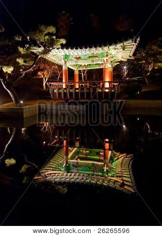 Night view of buddhist pavillion with water reflection at lansaft park at Jeju island  Korea