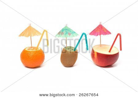 kiwi, mandarin and apple with umbrellas