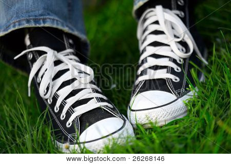 pair of sneakers in green grass