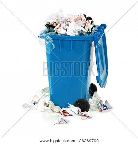 overflowing blue garbage bin on white background