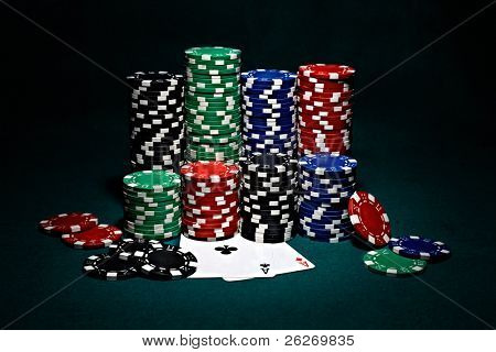 stacks of chips for poker with pair of aces