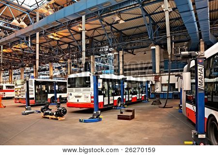 PRAGUE - SEPTEMBER 17: Maintenance of buses in workshop in Hostivar on Open Doors Day on September 17, 2011 in Prague. Prague Public Transport Company invites the public to view the workshops.