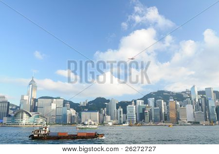 Hong Kong skyline with cargo container, ferry and helicopter