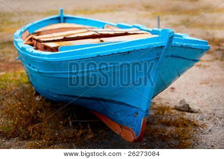 Old Blue Wooden Boat On Grassy Sand