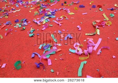 Party abstract confetti over red background