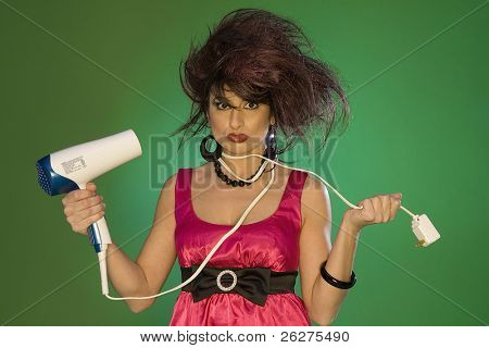 Model playing with a blow dryer