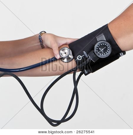 Young nurse, doctor or intern taking a patients blood pressure