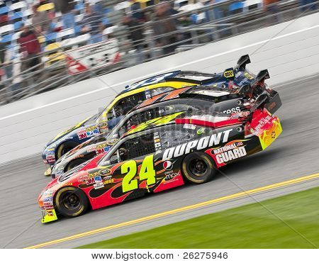 DAYTONA BEACH, FL - FEB 11:  Jeff Gordon, Denny Hamlin, AJ Almendinger make it three wide during the Gatorade Duel races at the Daytona International Speedway Feb 11, 2010 in Daytona Beach, FL.