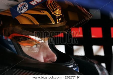 LONG POND, PA - JUNE 04:  Kurt Busch straps into his Miller LIte Dodge before a practice session for the Gillette Fusion ProGlide 500 race at the Pocono Raceway in Long Pond, PA on June 4, 2010