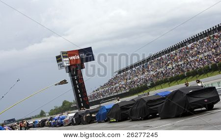 LONG POND, PA - JUNE 06:  The NASCAR Sprint Cup cars are lined up on pit road during the rain delay for the Gillette Fusion ProGlide 500 race at the Pocono Raceway in Long Pond, PA on June 6, 2010