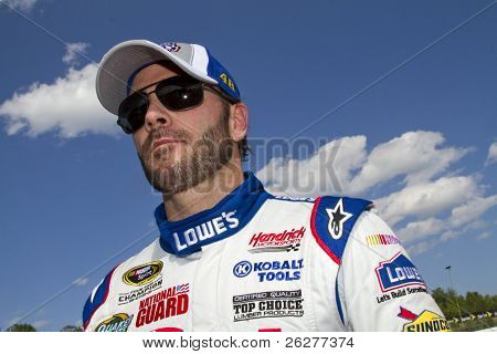 LOUDON, NH - JUNE 25: Jimmie Johnson gets out of his car after qualifying for the LENOX Tools 301 race at the New Hampshire Motor Speedway in Loudon, NH on June 25, 2010