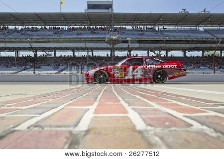 INDIANAPOLIS, IN - JULY 23:  Tony Stewart brings his Old Spice Chevrolet down pit road for the Brickyard 400 race at the Indianapolis Motor Speedway on July 23, 2010 in Indianapolis, IN.
