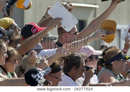 INDIANAPOLIS, IN - JULY 24:  Fans try to get their favorite drivers autographs at the Brickyard 400 race at the Indianapolis Motor Speedway on July 24, 2010 in Indianapolis, IN.