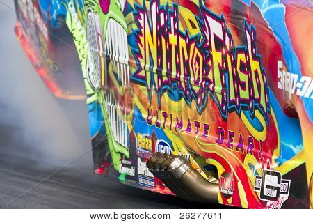 CONCORD, NC - MAR 27:  Tony Pedregon brings his Chevy Impala Funny Car down the track at the zMax Dragway for the running of the inaugural Four-Wide Nationals event in Concord, NC on Mar 27, 2010