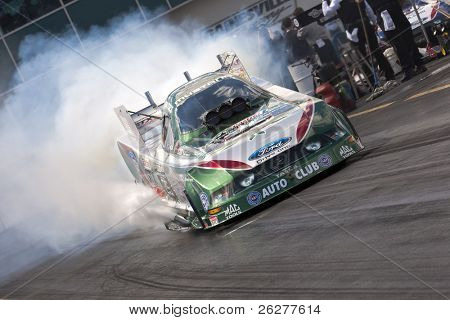 GAINESVILLE, FL - MARCH 13:   NHRA Funny Car driver, John Force, brings his car down the track during the 41st Annual Gatornationals at the Gainesville Raceway in Gainesville, FL on Mar 13, 2010