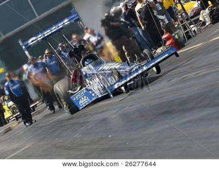 GAINESVILLE, FL - MAR 13:    Copart Top Fuel dragster, driven by Brandon Bernstein, launches off the line during the Gatornationals at the Gainesville Raceway in Gainesville, FL on March 13, 2010.
