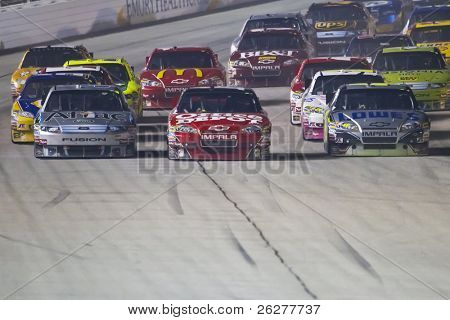 HAMPTON, GA - SEP 05:  Carl Edwards, Tony Stewart, and Jimmie Johnson make it three wide at the Healthcare 500 race at the Atlanta Motor Speedway in Hampton, GA on Sep 05, 2010.