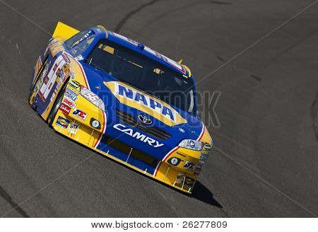 FONTANA, CA - OCT 08, 2010:  Martin Truex, Jr. brings his NAPA Chevrolet through the turns during a practice session for the Pepsi Max 400 race at the Auto Club Speedway in Fontana, CA on Oct 8, 2010.