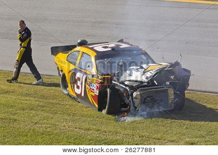 TALLADEGA, AL - OCT 31:  Jeff Burton exits out of his crashed CAT Chevrolet during the AMP Energy Juice 500 race on Oct 31, 2010 at the Talladega Superspeedway in Talladega, AL.