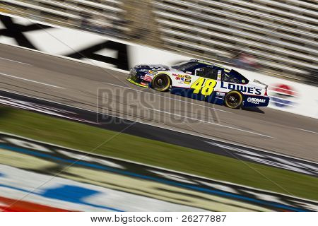 FORT WORTH, TX - NOV 06:  Jimmie Johnson (48) brings his race car down the frontstretch during practice for the AAA Texas 500 race on NOV 6, 2010 at the Texas Motor Speedway in Fort Worth, TX.