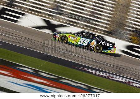 FORT WORTH, TX - NOV 06:  Carl Edwards brings his car through the frontstretch during a practice session for the AAA Texas 500 race on Nov 6, 2010 at the Texas Motor Speedway in Fort Worth, TX.