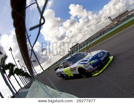 HOMESTEAD, FL - NOV 21:  Jimmie Johnson races off the back stretch for the Ford 400 race on Nov 21, 2010 at the Homestead-Miami Speedway in Homestead, FL.