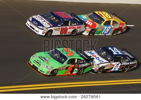DAYTONA BEACH, FL - FEB 11:  The NASCAR Sprint Cup teams bring their race cars through turn 4 at the Daytona International Speedway on Feb 11, 2011 in Daytona Beach, FL