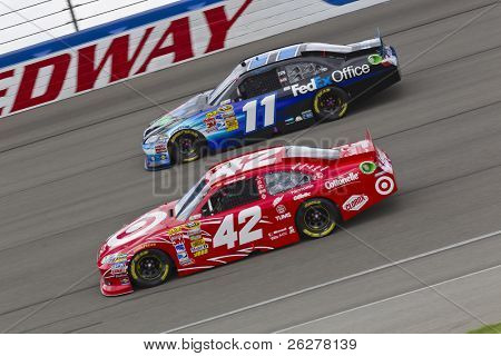 FONTANA, CA - MAR 27:  Denny Hamlin (11) and Juan Pablo Montoya (42) battle for position during the Auto Club 400 NASCAR Sprint Cup race at the Auto Club Speedway in Fontana, CA on Mar 27, 2011.