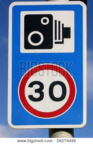 30 miles per hour speed and speed camera sign.