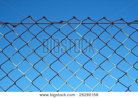 Rusty wire security fence.