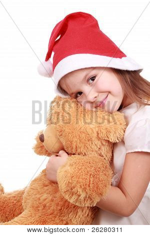 santa's hat, little girl and a fluffy toy