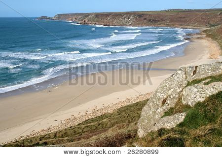 Atlantic waves reaching the beach at Sennen Cove, Cornwall, UK