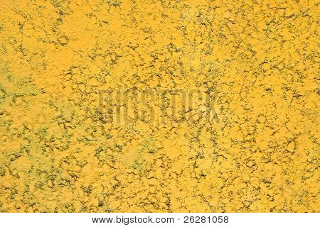 Close up of a tarmac road parking area painted yellow.