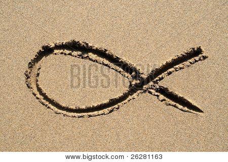 Ichthys, a Christian religious fish symbol, drawn on a beach.