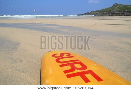 A surf board on the beach, St. Ives, Cornwall.