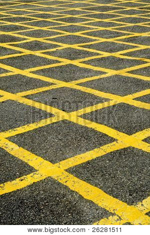 Close up of the yellow lines of a British road box junction.