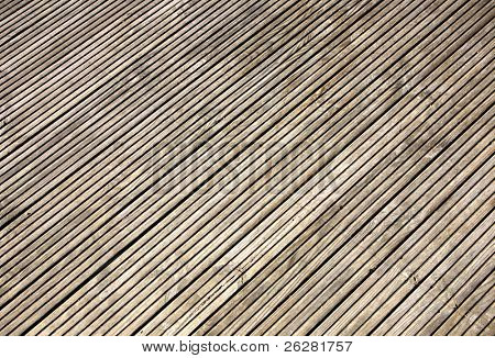 Grooved wooden garden decking close up.