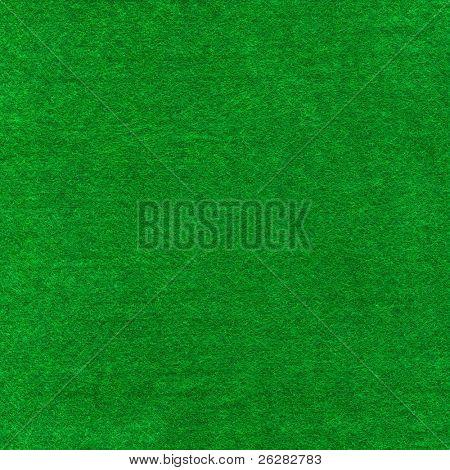 Green poker card table cloth macro close up.