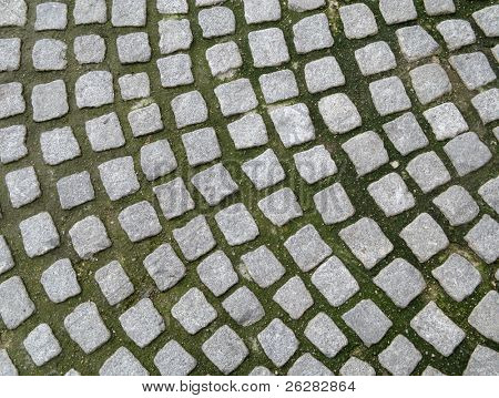 Close up of old cobblestones paving.