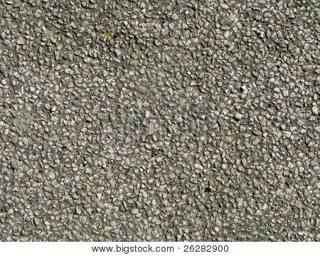 Velhas pedras da estrada alcatroada perto fundo de textura.
