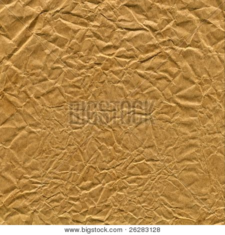 Old crumpled brown paper bag close up texture background.