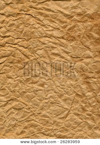 Crumpled brown paper bag close up texture background.