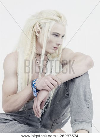 Photo of young handsome elf on a white background
