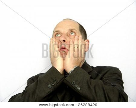 Businessman with a shocked look on his face isolated on white background