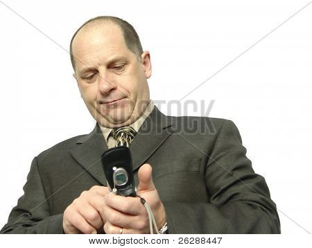 Businessman making a call on a cellular phone isolated on white background