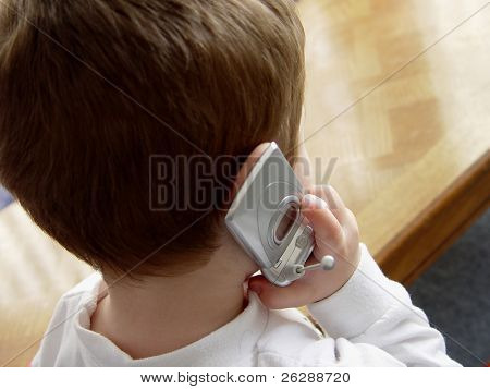 Little Boy talking on cellular phone