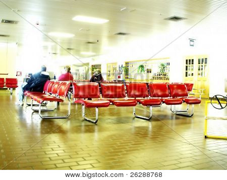 Abstract View of a Airport Lounge with people sitting down, high key