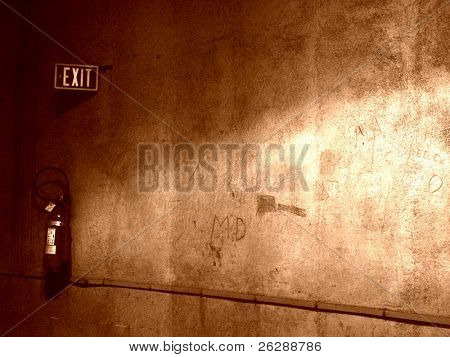 Grunge Exit sign and wall Inside a Iron Ore Mine, very dirty place
