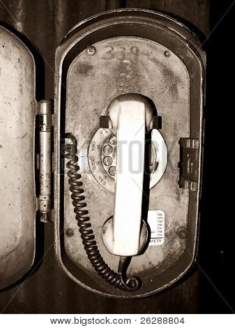 Grungy old Telephone Inside a Iron Ore Mine